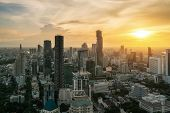 Bangkok, Thailand In Downtown Area Skyline View During Sunset Time From Rooftop In Bangkok. Asian To poster