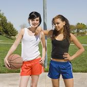 Two Teens Play Basketball
