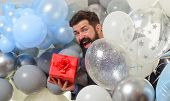 Festive Event Or Birthday Party. Happy Birthday Guy Holds Helium Balloons And Gift Box. Handsome Man poster