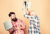 Men Work Writing Devices. Senior Man With Typewriter And Hipster With Laptop. Battle Of Technologies poster