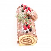 yule log, christmas pastry with chocolate and berries fruit on white background poster