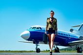 Full Length Of Airhostess On Private Jet Airplane On Airport. Airline. Airplane And Woman. Charming  poster