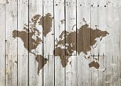 World Map On A Vintage Wooden Wall poster