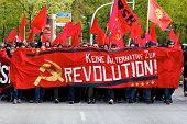 Protesters March With Red Banners