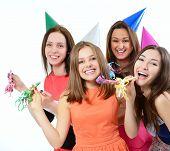 Joyful teen girls have fun on birthday party, over white