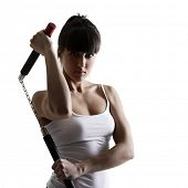 sport karate girl doing exercise with nunchaku, fitness woman silhouette studio shot over white back
