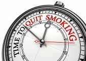 picture of tobacco smoke  - time to quit smoking concept clock on white background with red and black words - JPG