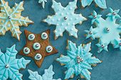 image of christmas cookie  - Fondant covered Christmas cookies in turquoise on tablecloth - JPG
