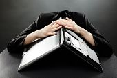 pic of nervous breakdown  - Stressed businesswoman with her laptop on her head in closeup pose on grey background - JPG