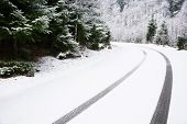 pic of icy road  - Car tire tracks on the snow - JPG