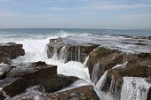 Water Flowing Away From Rocks In Newcastle Beach
