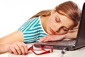 girl sleeping on her laptop