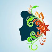 Happy Women's Day greeting card or background with a blue silhouette of a women with floral decorati