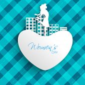 Happy Women's Day greeting card or background with white silhouette of a happy girl on heart and urban city on abstrct blue background.