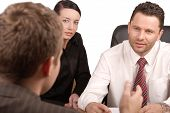 pic of business meetings  - three persons business meeting    - JPG