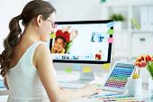 stock photo of single woman  - Portrait of pretty female designer working with colors at home - JPG