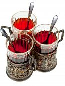 pic of melchior  - three retro glasses in silver glass holders with spoon with black tea isolated on white background - JPG