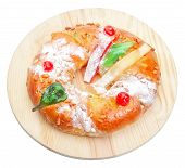Portuguese King Cake On A Wooden Stand. On A White Background. Isolated.