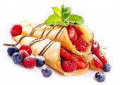 Crepes With Berries. Crepe with Strawberry, Raspberry, Blueberry and Chocolate topping