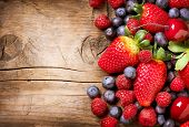 pic of strawberry plant  - Berries on Wooden Background - JPG