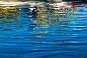 Colorful Reflections In Rippled Water