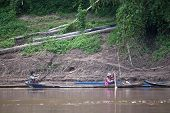 Villagers on a boat on Nam Ou river