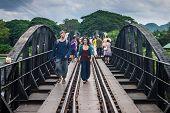 Tourists on the bridge over the river Kwai