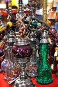 picture of shisha  - Assortment of traditional water pipes on market - JPG