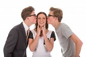 Male twins kissing a beautiful woman