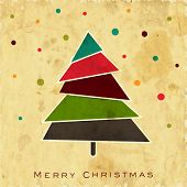 Vintage Merry Christmas background with colorful Xmas tree on grungy background.