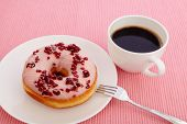 Cranberry Donut With A Cup Of Coffee