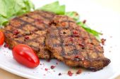 Pork Steak,grilled With Salad And Tomato