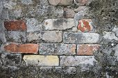 stock photo of burial-vault  - Colorful but weathered bricks used to repair an above ground burial vault in St - JPG