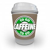 The words Caffeine To Go on a plastic coffee cup from a cafe or restaurant