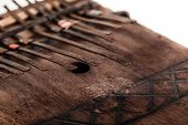 foto of idiophone  - an african instrument named Mbira that consists of a wooden board with attached staggered metal keys - JPG
