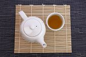 healthful green tea and teapot for afternoon tea time