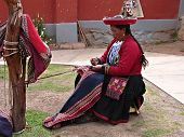 Woman shows and tells about production of the clothes.