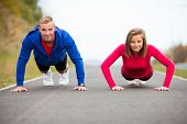 Young woman and man exercising