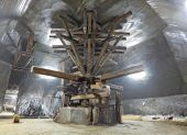 stock photo of salt mines  - Old traditional extraction machine in a salt mine gallery in TurdaTransylvaniaRomania - JPG