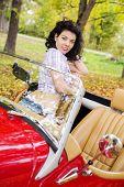 Woman At Retro Car On Passanger Seat