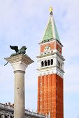 Campanile and winged lion on San Marco square, Venice, Italy