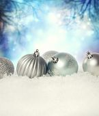Christmas Baubles On The Snow