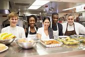 pic of charity relief work  - Portrait Of Kitchen Staff In Homeless Shelter - JPG