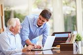 picture of grandfather  - Teenage Grandson Helping Grandfather With Laptop - JPG