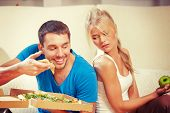 stock photo of envy  - bright picture of couple eating different food - JPG