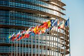 foto of democracy  - The European Parliament building in Strasbourg France with flags waving on a spring evening - JPG