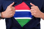 Young Sport Fan Opening His Shirt And Showing The Flag His Country Gambia, Gambian Flag