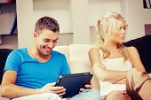 foto of envy  - bright picture of couple with tablet PC - JPG