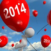 Two Thousand Fourteen On Balloons Shows Year 2014