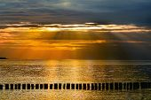 Falling sunbeams over the baltic sea in the evening